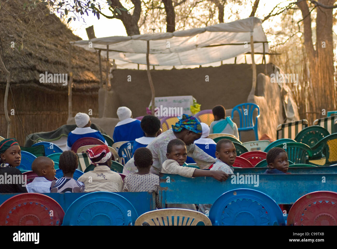 Church congregation gather for Pastor's sermon at Seventh Day Adventist meeting near Kongola, in the Caprivi, - Stock Image