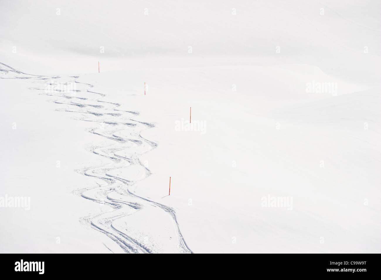 Austria, Zurs, Lech, View of ski tracks in snow - Stock Image