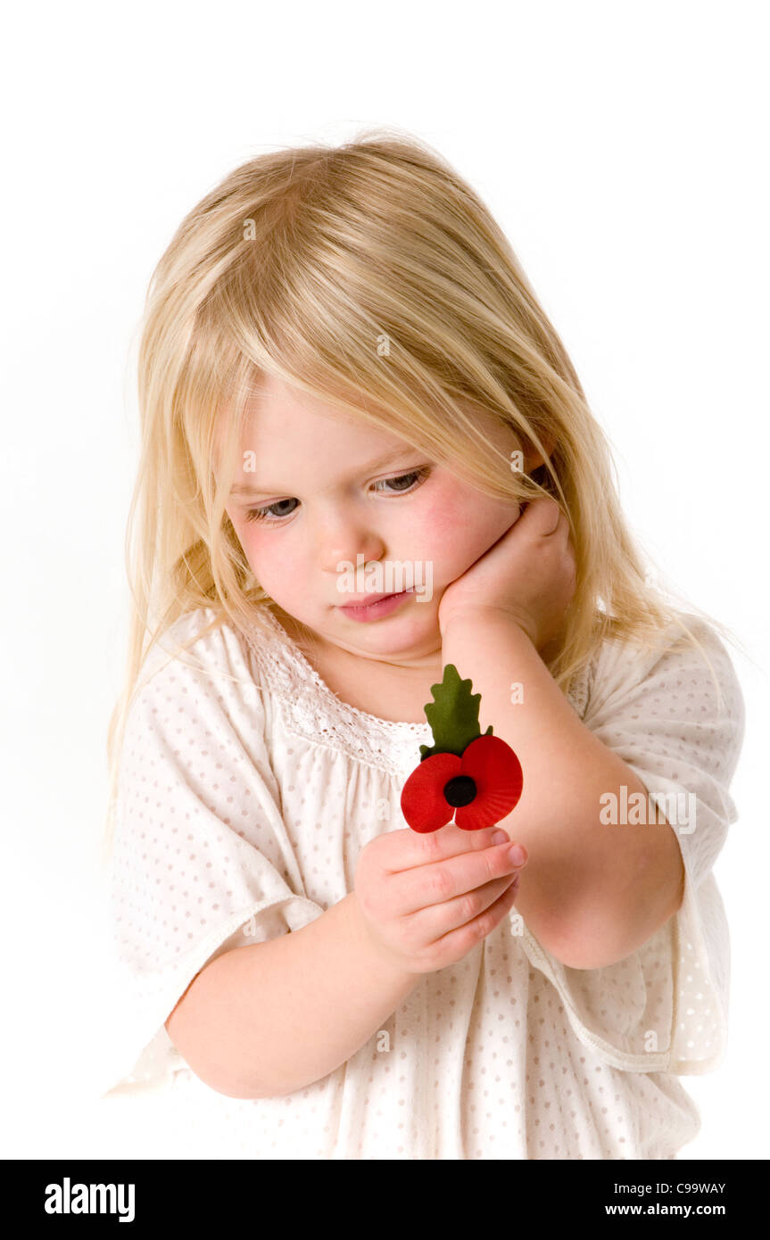 poppy poppies war soldier orphan orphaned orphans soldiers daughter British legion remembrance day conflict world - Stock Image