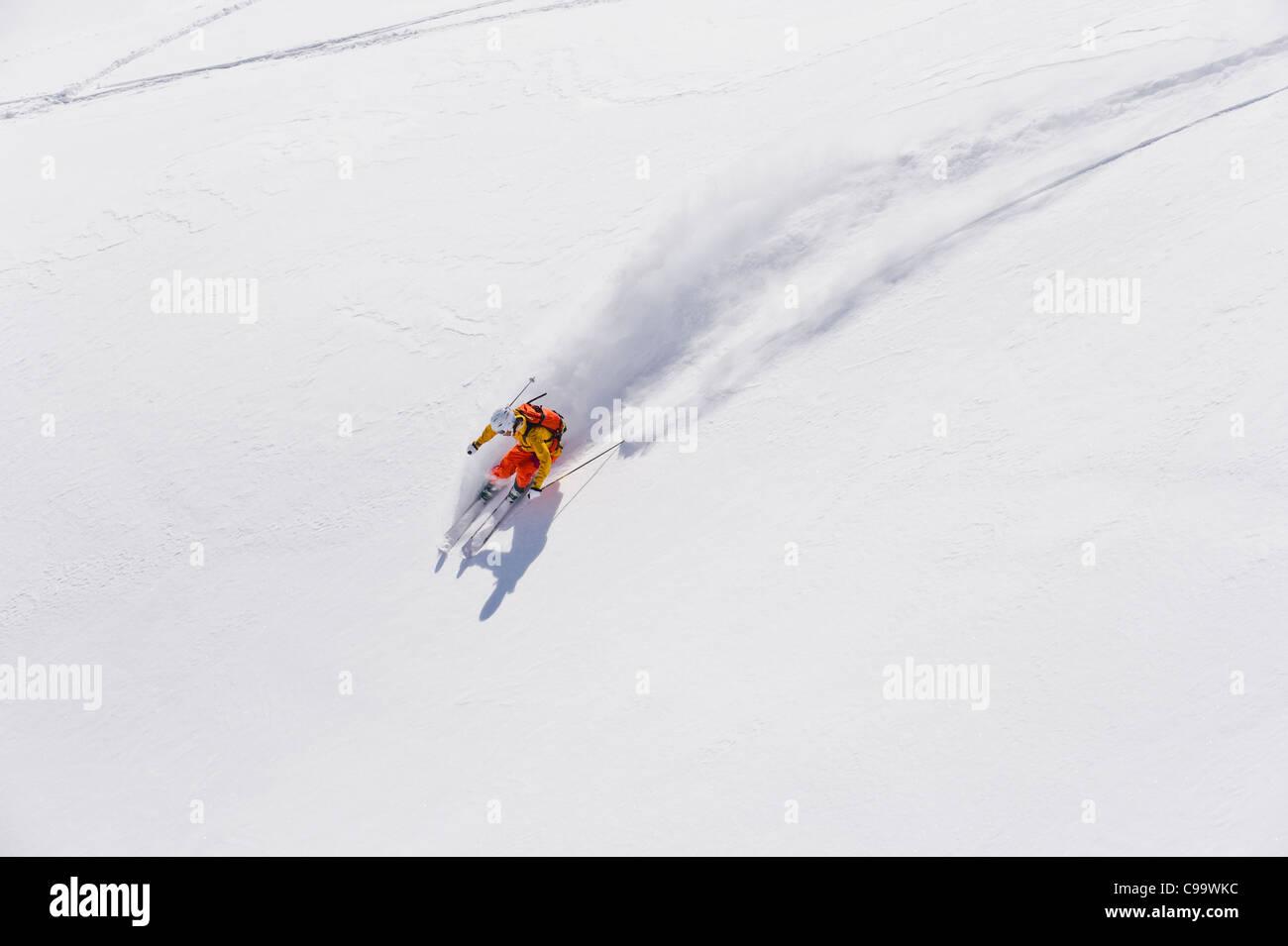 Austria, Young woman doing alpine skiing - Stock Image