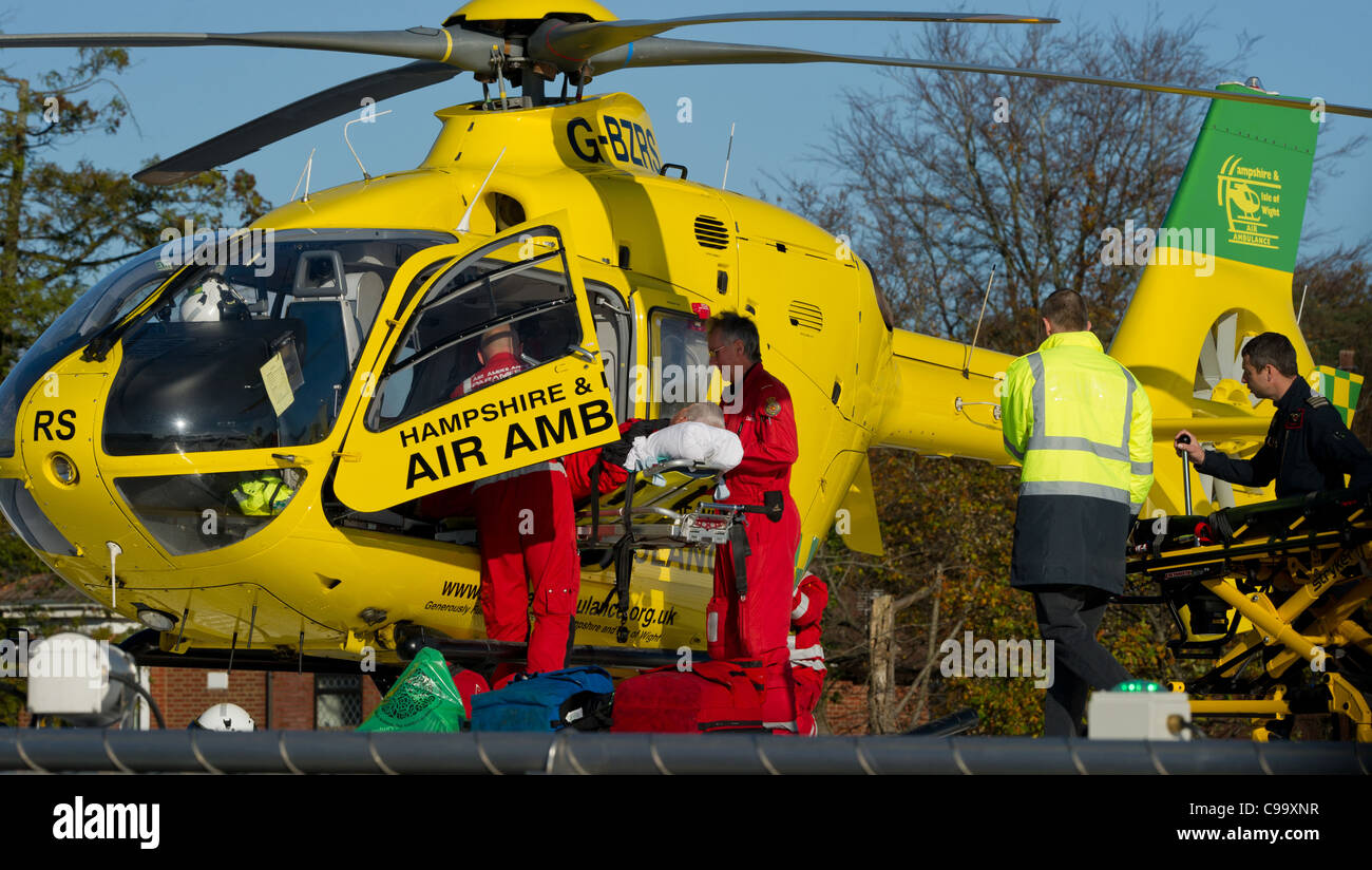 Hampshire and isle of wight brings in a patient to Southampton general hospital  helicopter pad - Stock Image