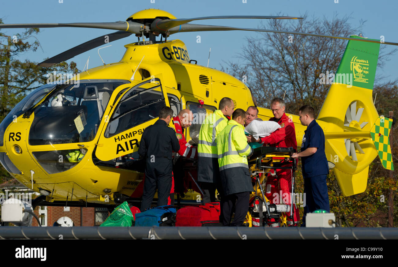 The Hampshire and isle of wight air ambulance brings in a patient at Southampton General hospital helicopter pad - Stock Image