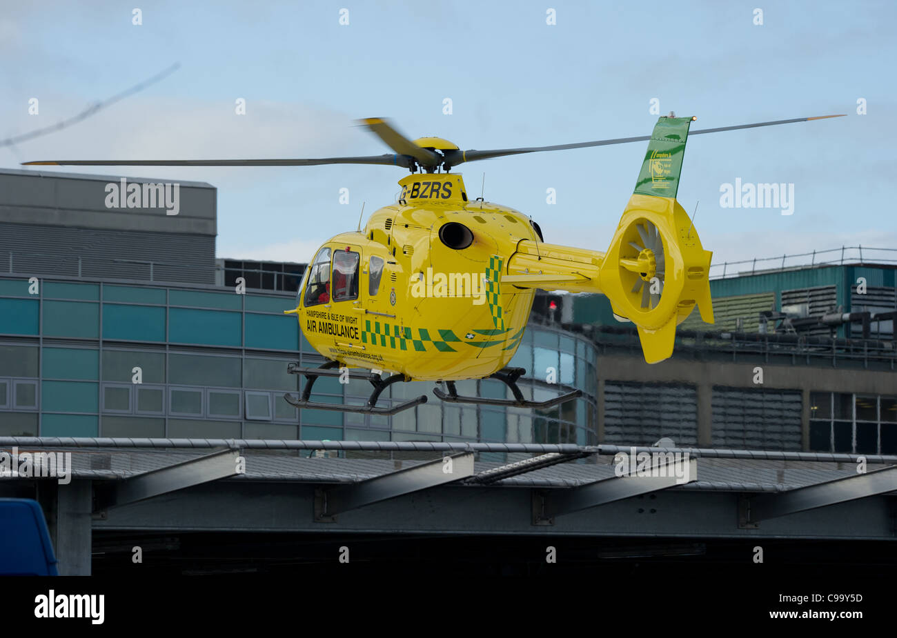 the hampshire and isle of wight air ambulance comes into land at Southampton General hospital on the Helipad - Stock Image