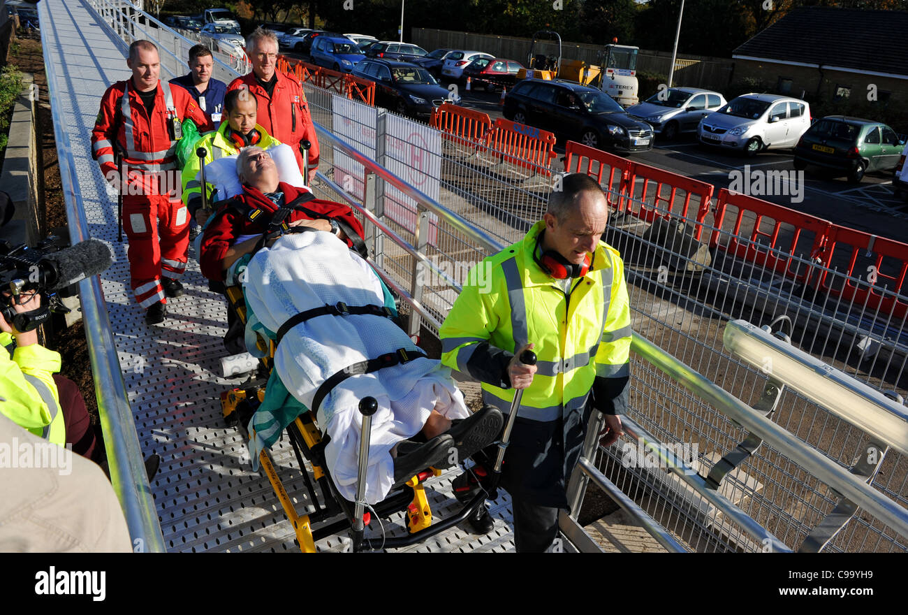 A patient is brought into Southampton general hospital by air ambulance and is taken to A&E by medics and porters - Stock Image