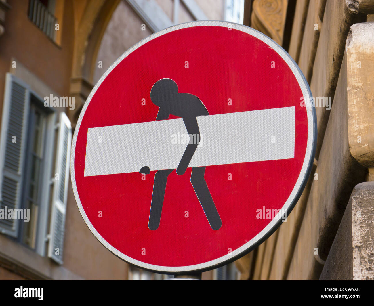Italy, Rome, Stop sign modified with stealing man, close up - Stock Image