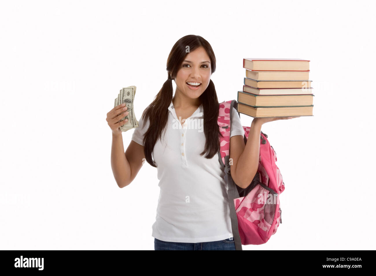 Ethnic Hispanic college student holds 100 (one hundred) dollar bills happy getting money help to subsidies costly - Stock Image