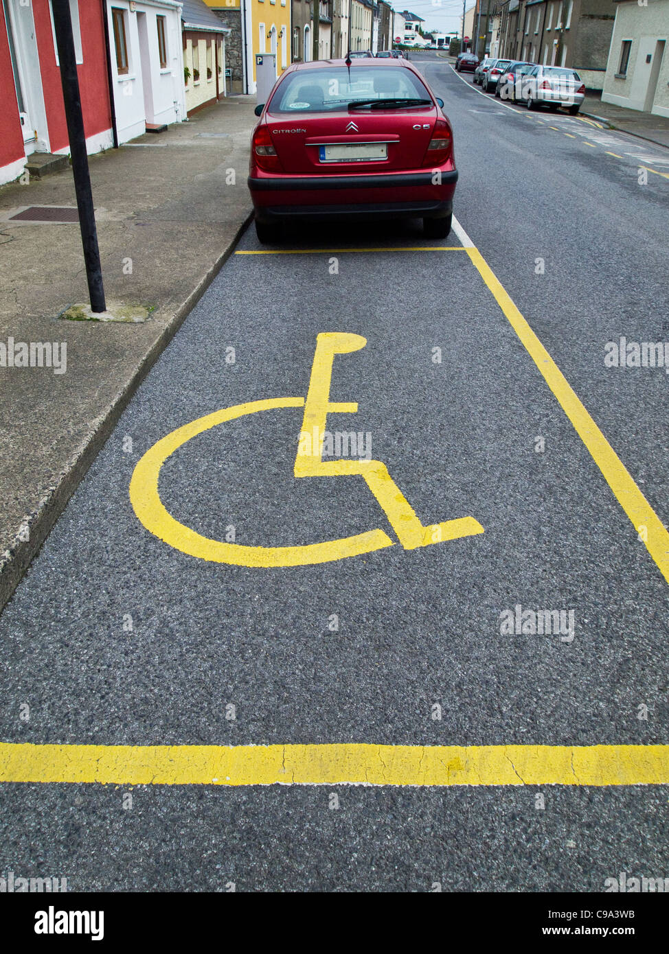 A parking place for handicapped or disabled drivers - Dublin Ireland - marked by the international symbol - Stock Image
