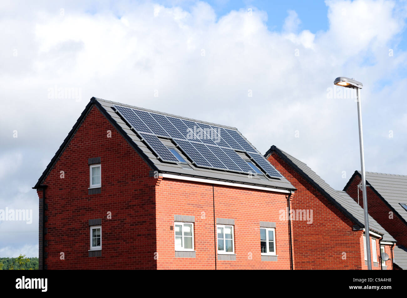 New Build House With Solar Panels. - Stock Image