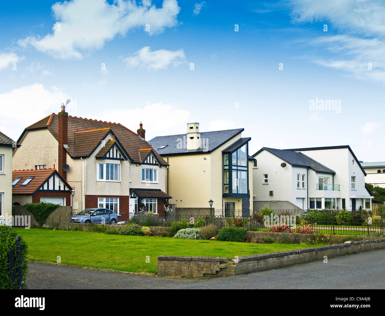 Three different house styles in a Dublin suburban town, overlooking the beach - Skerries, county Dublin, Ireland - Stock Image