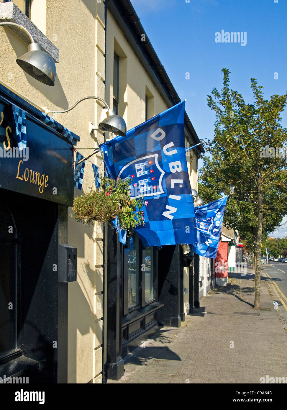 Flags of the Dublin county Gaelic football team festooning a pub in Skerries, co. Dublin, Ireland (All-Ireland champions - Stock Image