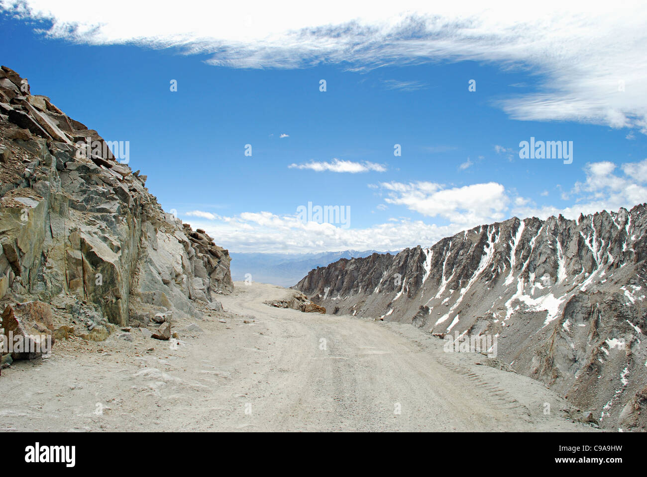 A road to Leh with snow clad Himalayan Mountain Ranges on both sides from the Changla Pass or Chang La Pass (el. - Stock Image