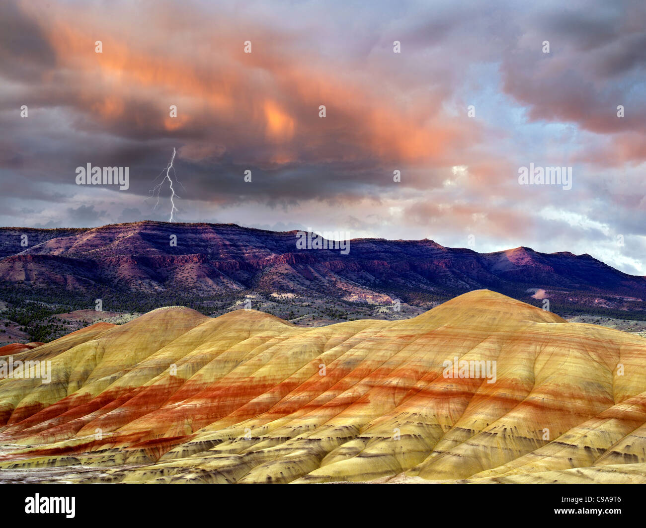 Storm clouds lightening strike and sunset. Painted Hills, John Day Fossil Beds National Monument, Oregon. - Stock Image