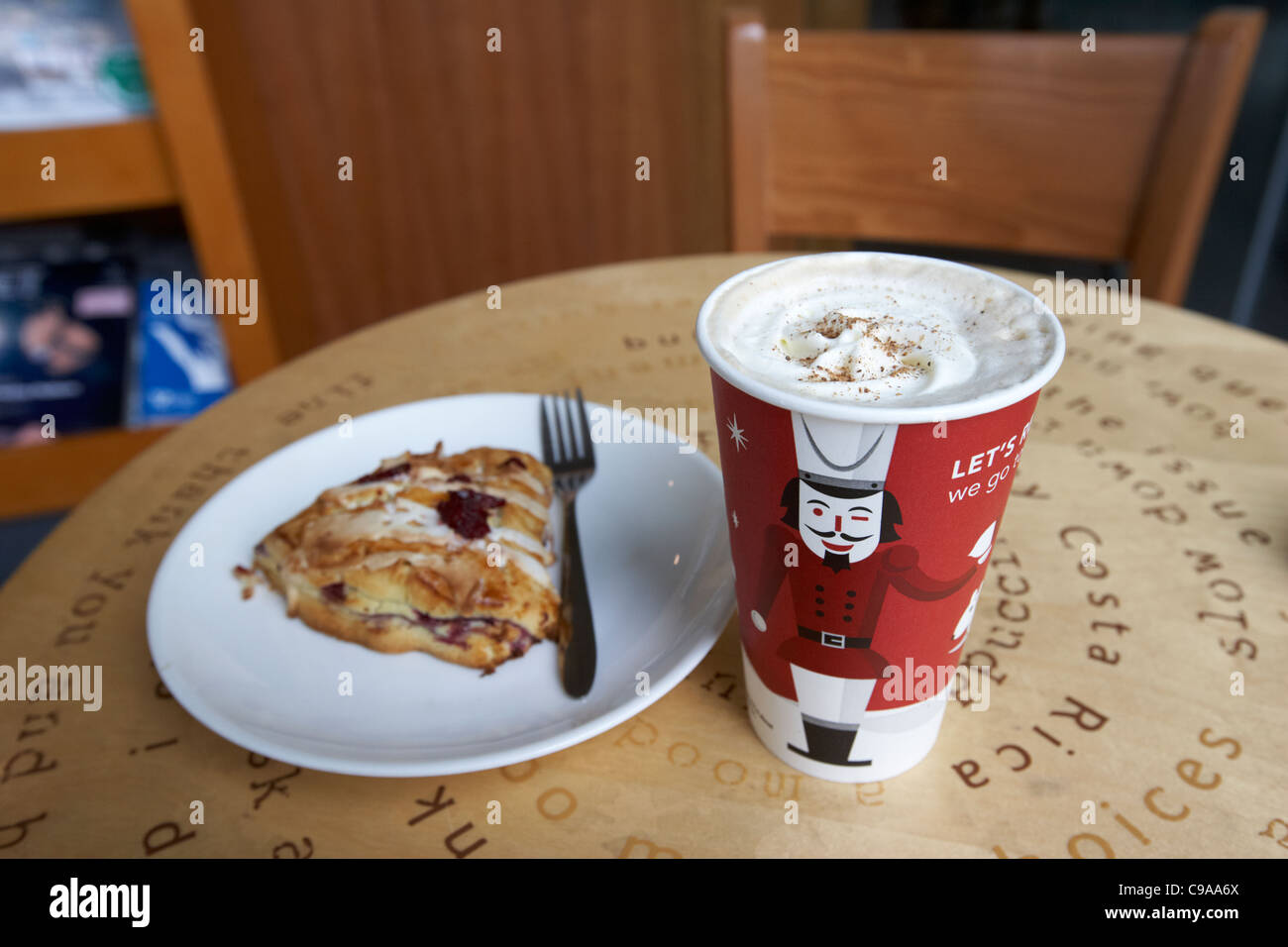 starbucks gingerbread latte seasonal christmas coffee and cranberry pastry - Stock Image
