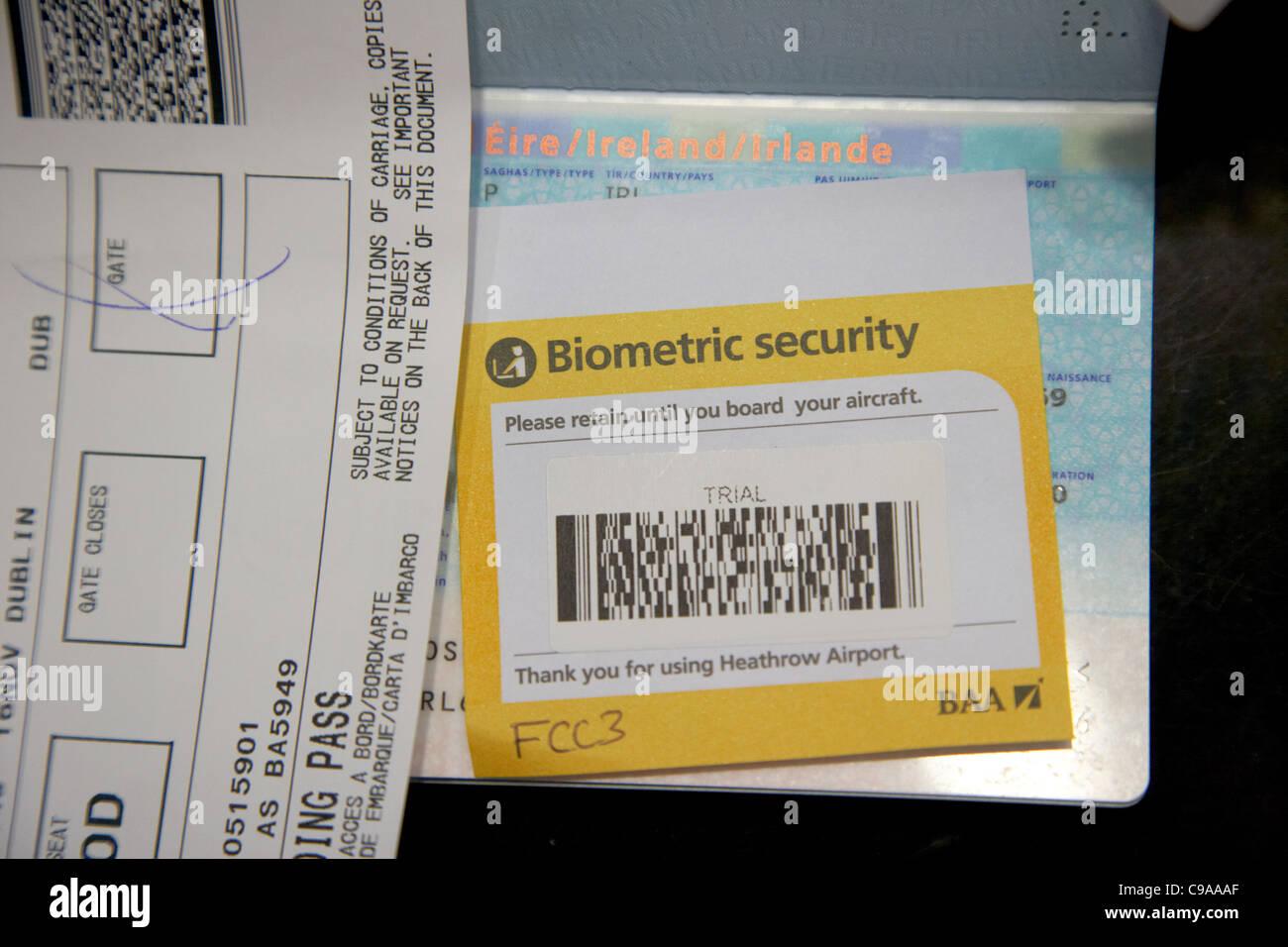 uk border control biometric security trial barcode sticker inserted in an eu irish passport at heathrow airport - Stock Image