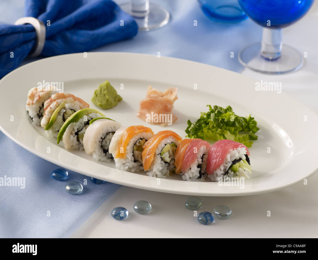 Rainbow roll of sushi - Stock Image