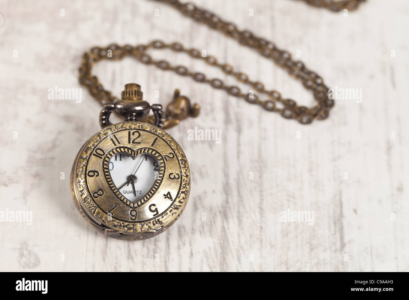 Nice vintage pocket watch on wooden background - Stock Image