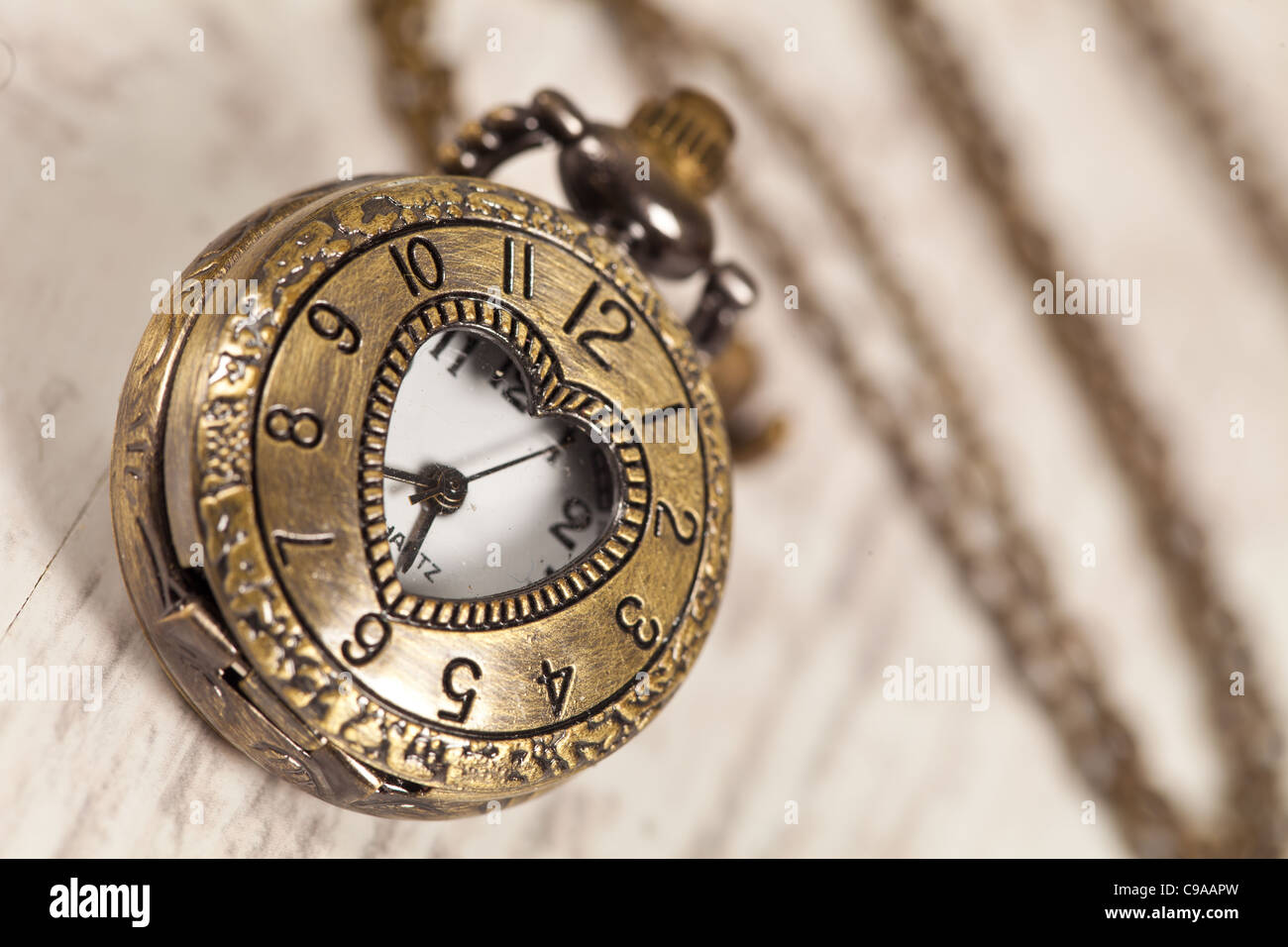 Nice vintage pocket watch on wooden background - Stock Image