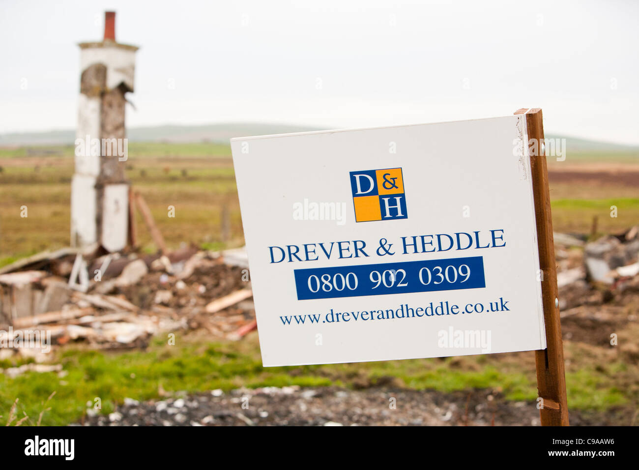 A for sale sign next to a totally collapsed house on mainland Orkney, Scotland, UK - Stock Image