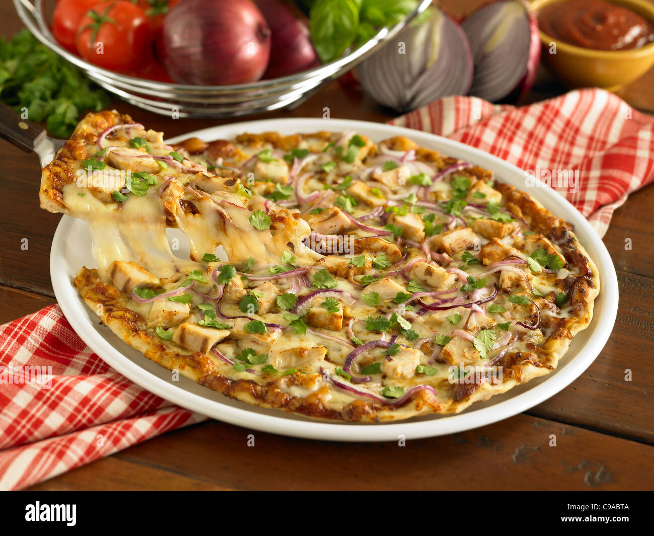 Barbecue chicken pizza pull - Stock Image