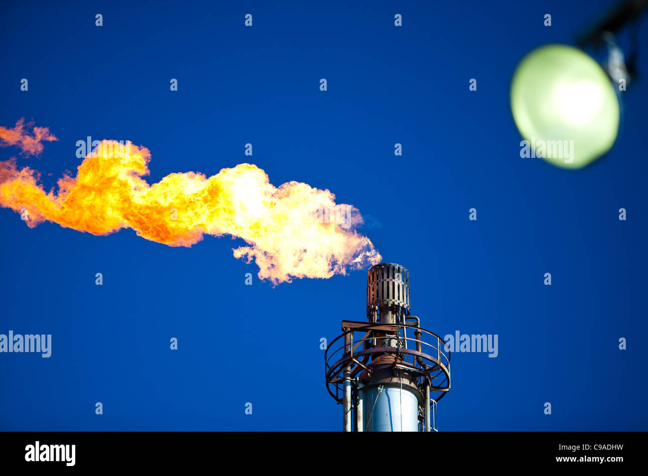 Flaring off gas at the Flotta oil terminal on the Island of Flotta in the Orkney's Scotland, UK. - Stock Image