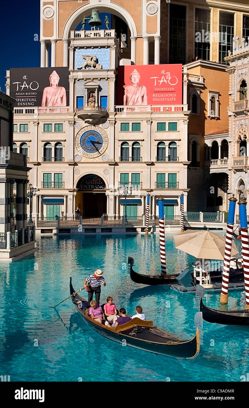 USA, Nevada, Las Vegas, The Strip, tourists in gondola outside the entrance to the Venetian hotel and casino. - Stock Image