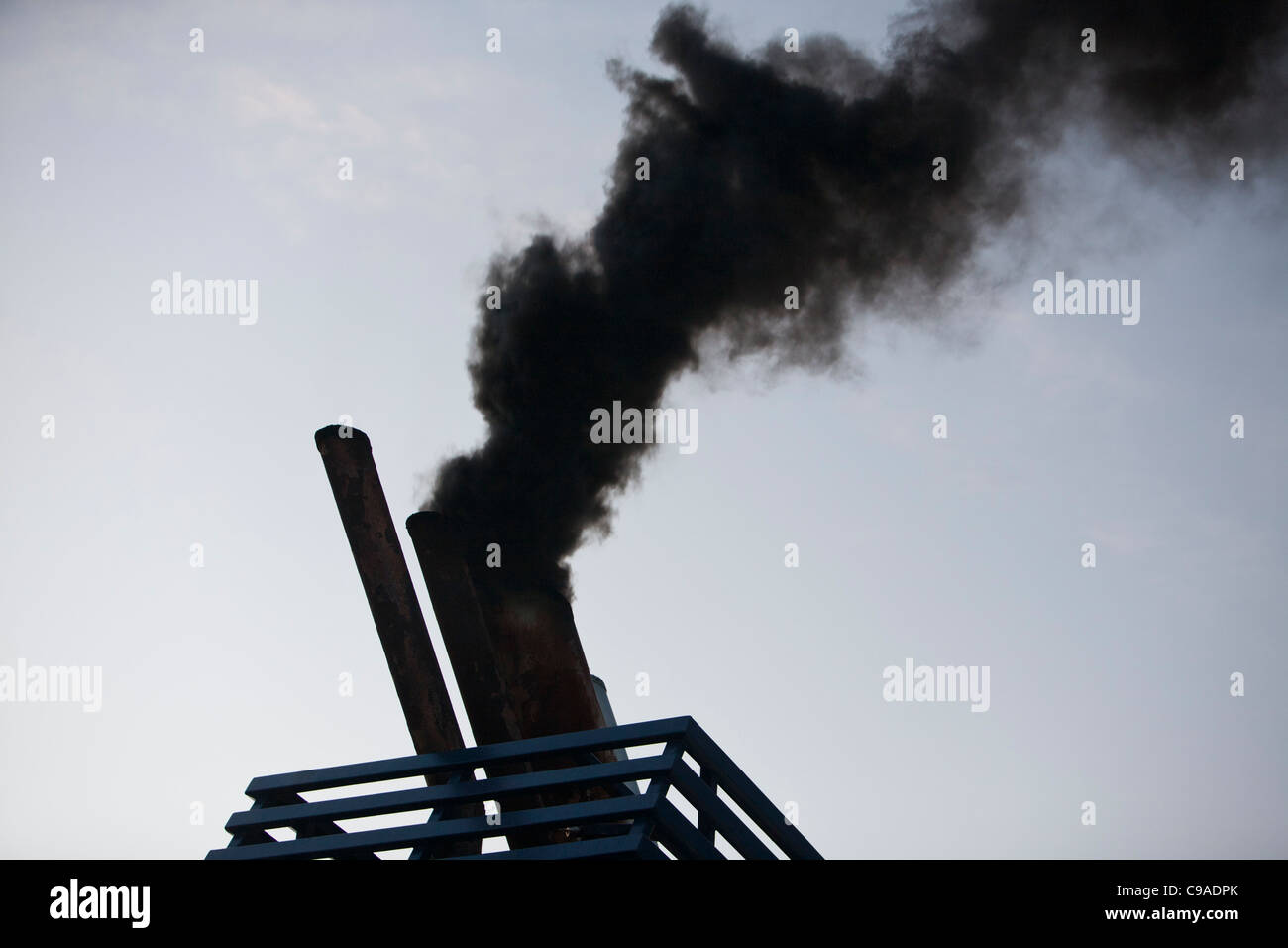 Exhaust emissions, the result of burning marine diesel in a ships engine. Marine diesel is one of the most polluting - Stock Image
