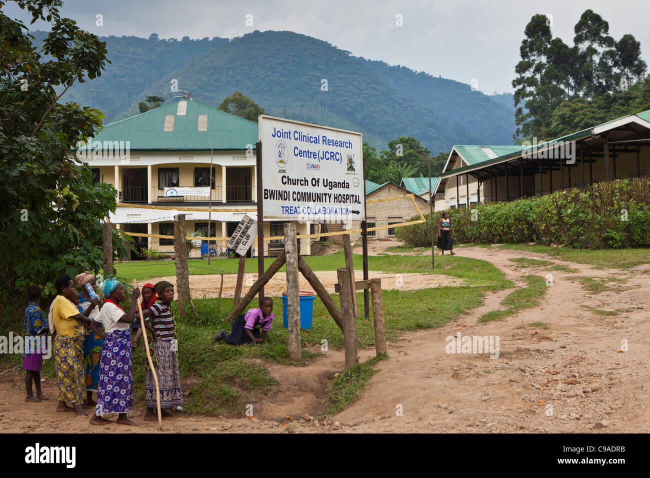 Elderly patients arrive at the gates of Bwindi Community hospital in the town of Buhoma, Uganda. - Stock Image