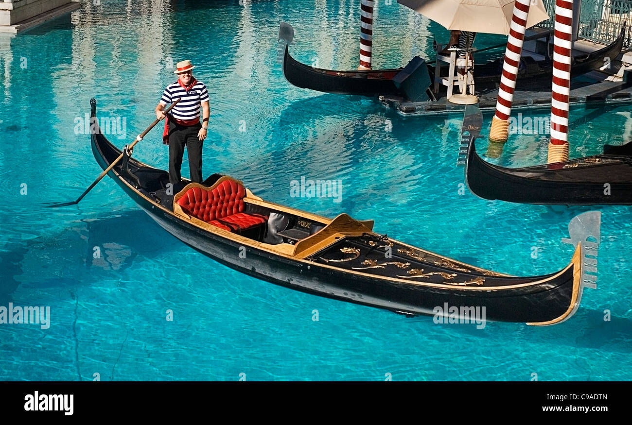 USA, Nevada, Las Vegas, The Strip, gondola outside side the entrance to the Venetian hotel and casino. - Stock Image