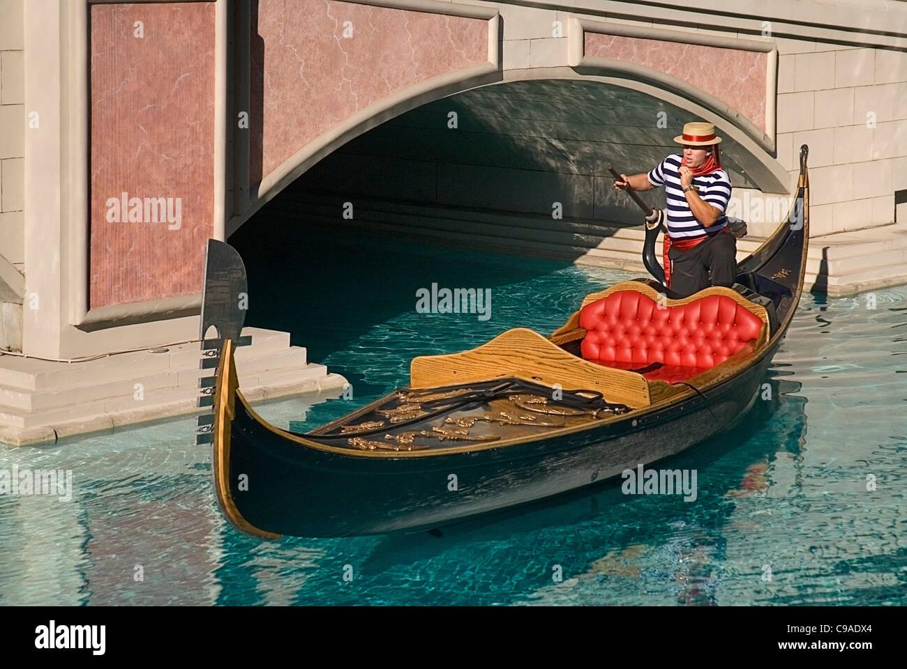 USA, Nevada, Las Vegas, The Strip, gondola outside side the entrance to the Venetian hotel and casino. - Stock Image