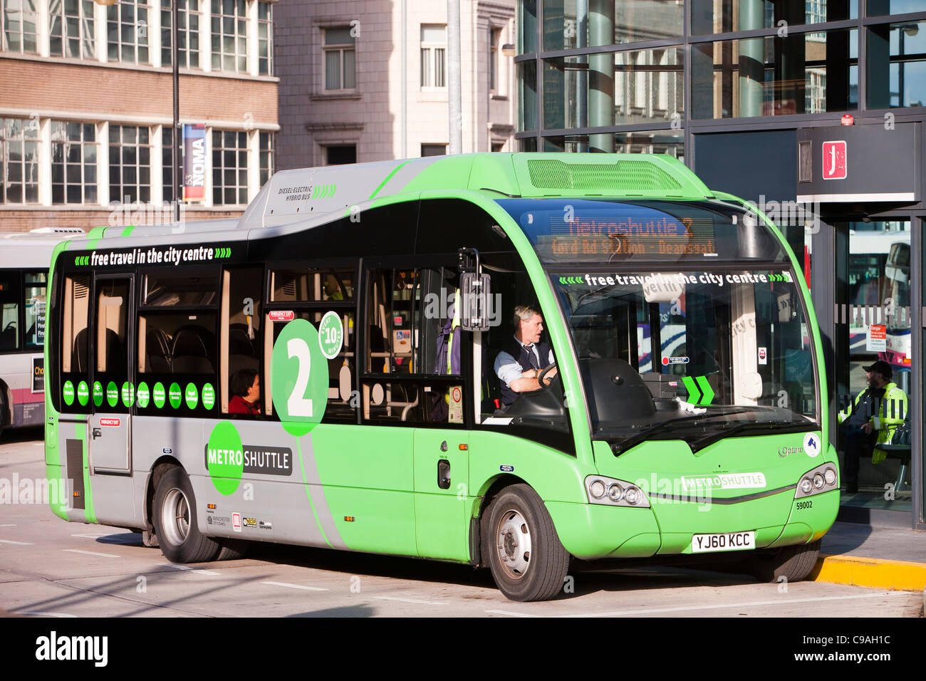 A hybrid diesel electric shuttle bus that is a free bus service around Manchester city centre, UK. - Stock Image