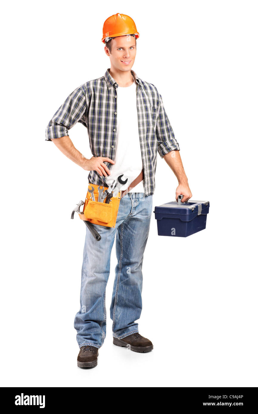 Full length portrait of a confident and smiling manual worker holding a wrench and a toolbox - Stock Image