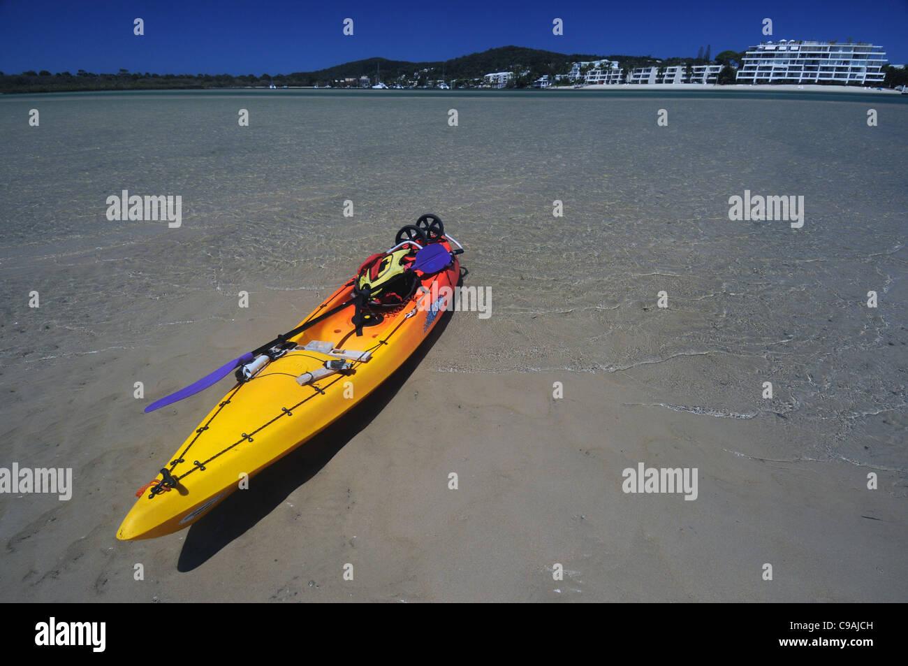 Kayak on sandbar in the Noosa River estuary, Sunshine Coast, Queensland, Australia. No PR - Stock Image