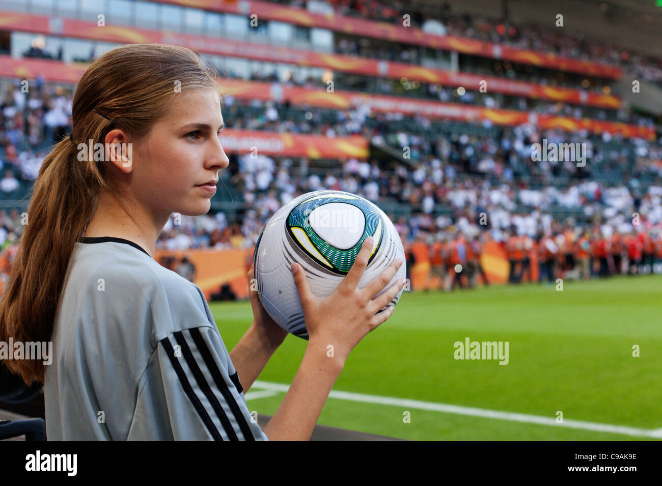 A ball girl holds an official match ball at the 2011 FIFA Women's World Cup Group A match between France and - Stock Image