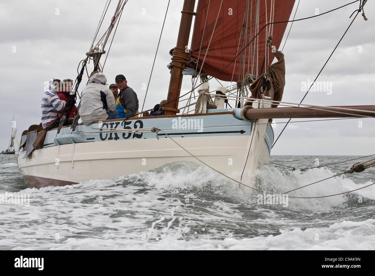 Oyster smack under sail off West Mersea. - Stock Image