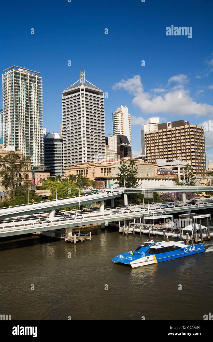 A CityCat ferry at North Quay pier with city skyline in background.  Brisbane.  Brisbane, Queensland, Australia - Stock Image