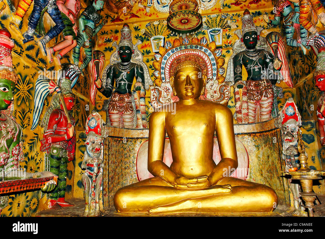 Golden Buddha Colorful Deity Deities Temple India Indian religion traditional - Stock Image