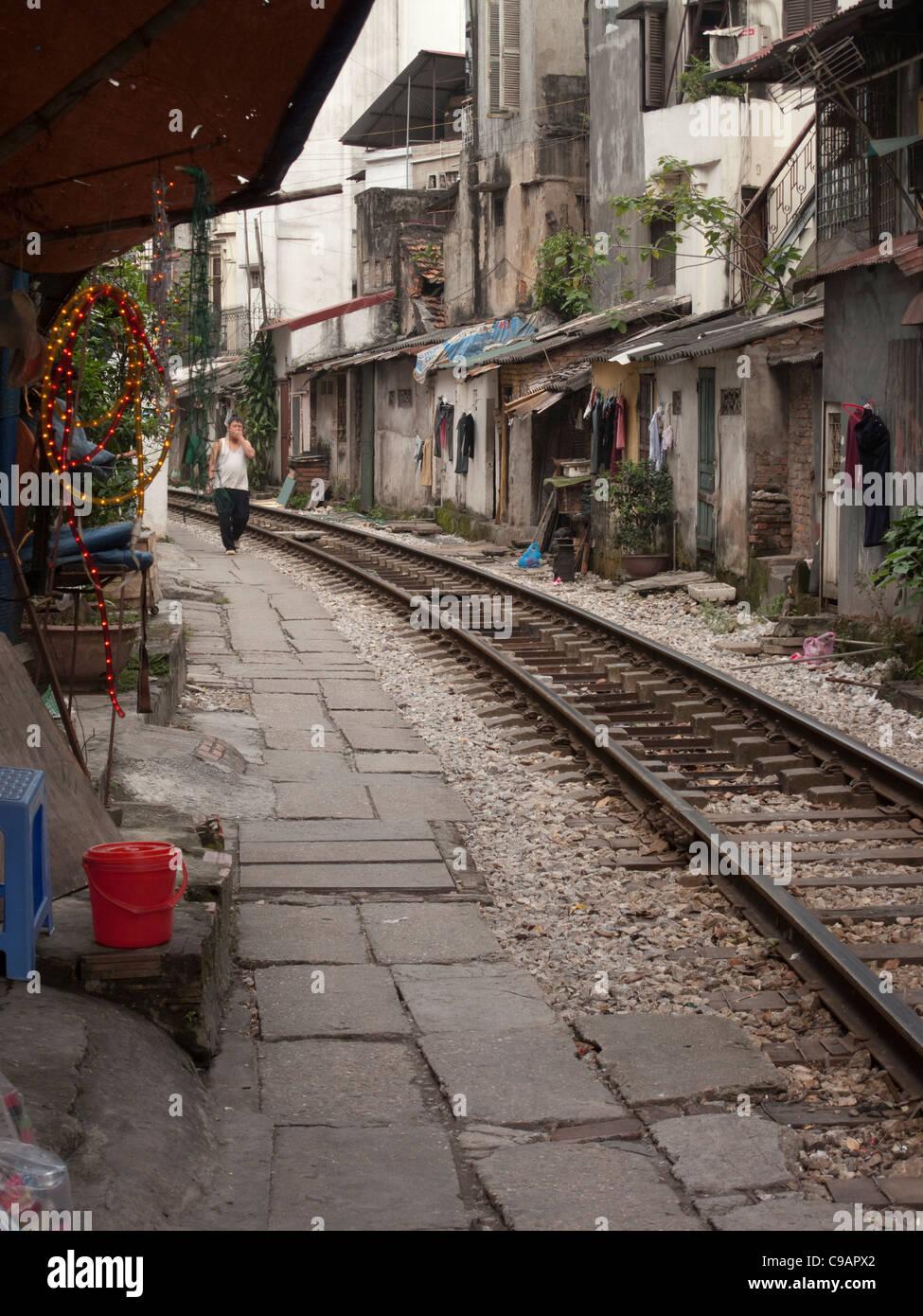 Rail track through housing in Hanoi, Vietnam - Stock Image