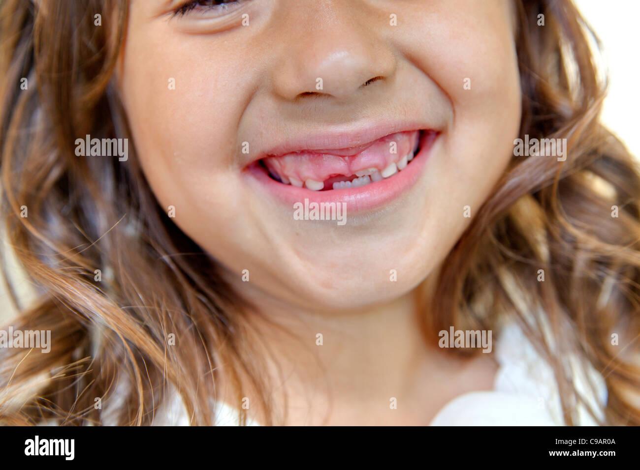 Girl teething - Stock Image
