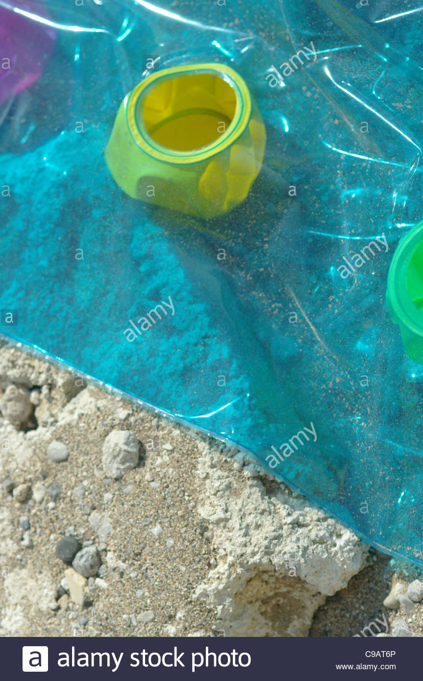 Plastic,beach,toys,thrown,away,at,the,seaside - Stock Image