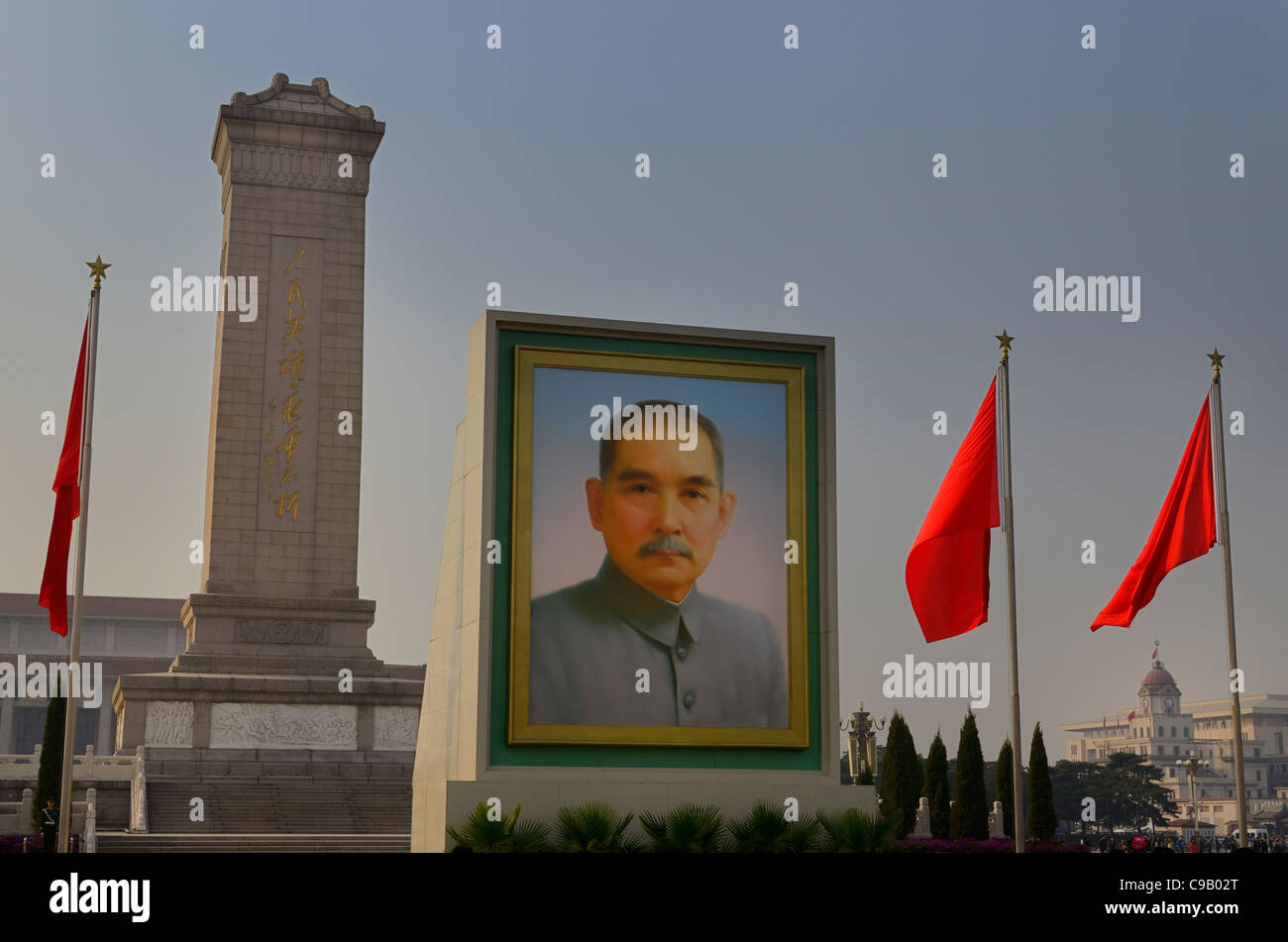 Portrait of Sun Yat Sen with Monument to the Peoples Heroes in Tiananmen Square Beijing  with red China flags - Stock Image