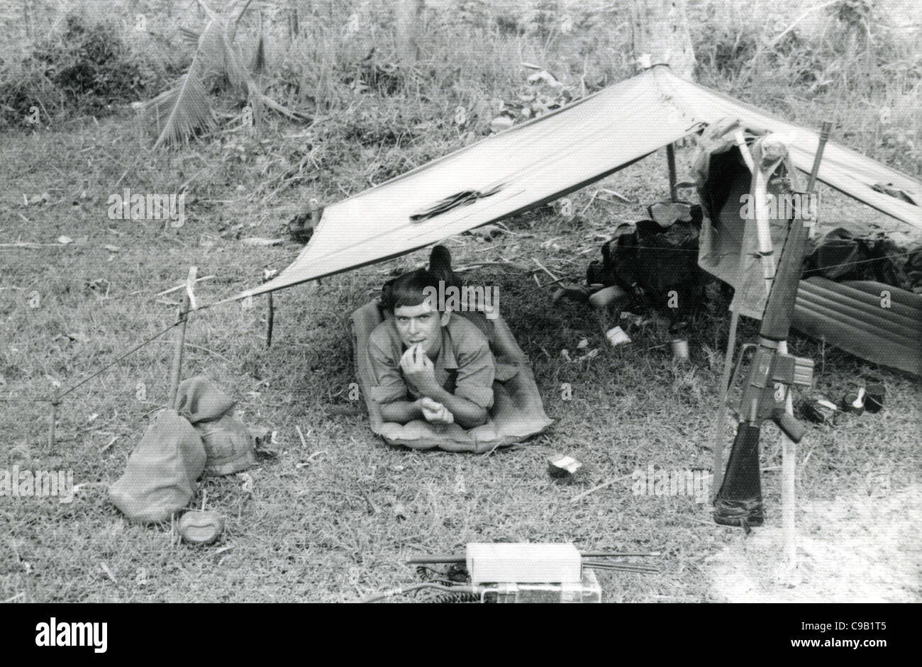 American solider under pup tent next to M16  101st ABN in