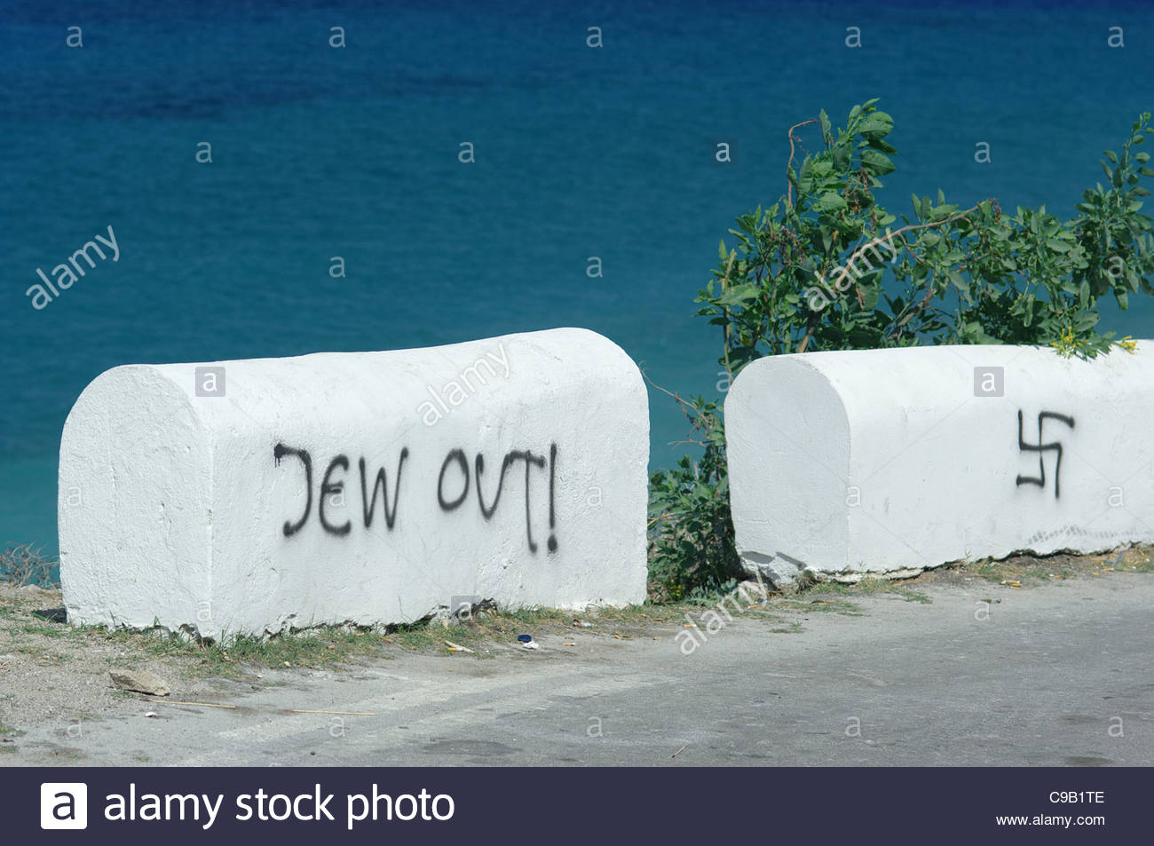 """Europe, Greece, View Of Roadside 'Jew Out! Message, Anti-Jewish Graffiti (Who Locals Say Was """"Painted By Turks"""") Stock Photo"""