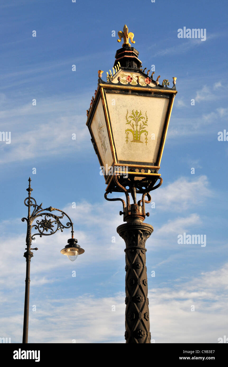 Two different types of old ornate Victorian street lamps and lamp posts. - Stock Image