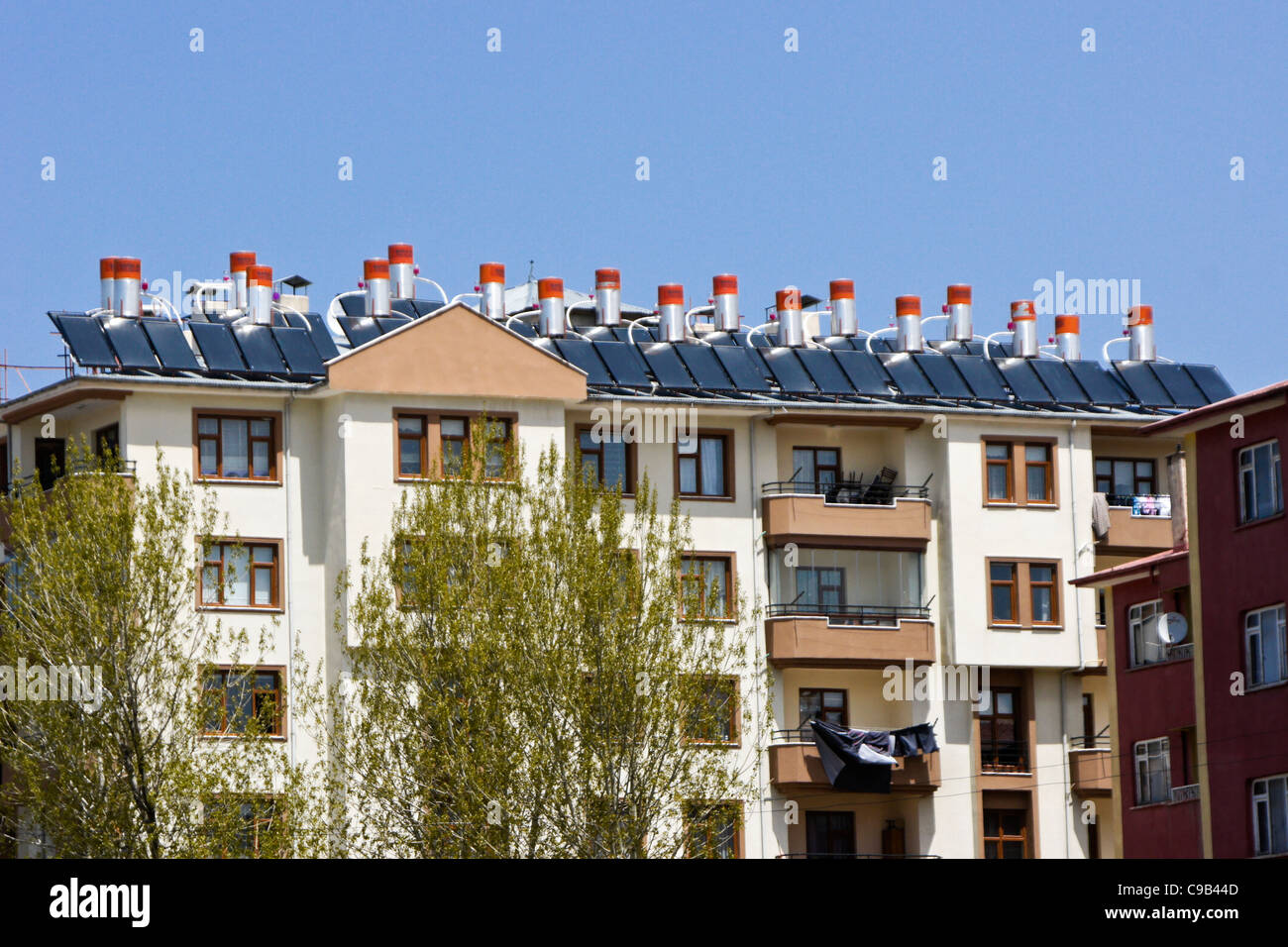 Apartment buildings with solar panels and water tanks on roof, Van, Eastern Anatolia, Turkey Stock Photo