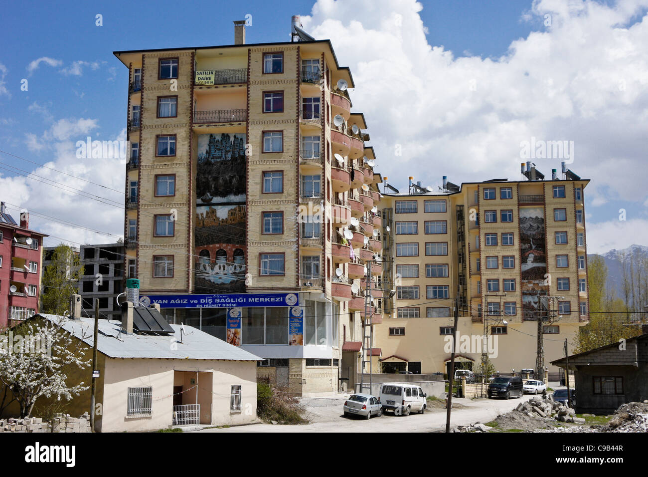 Apartment building with solar panels and water tanks on roof, Van, Eastern Anatolia, Turkey Stock Photo