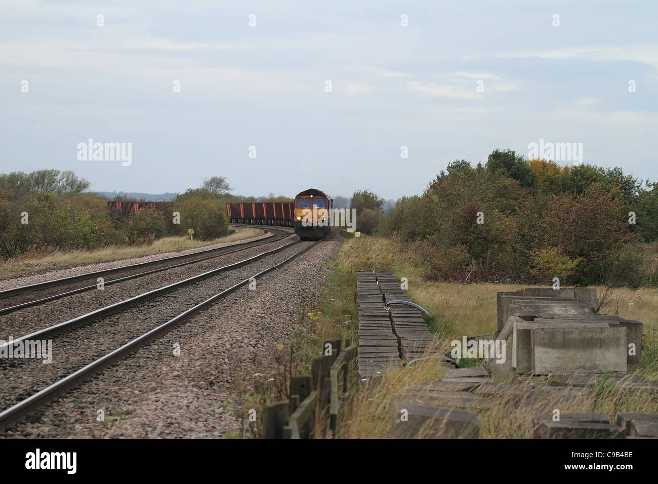 goods train freight train on railway tracks - Stock Image