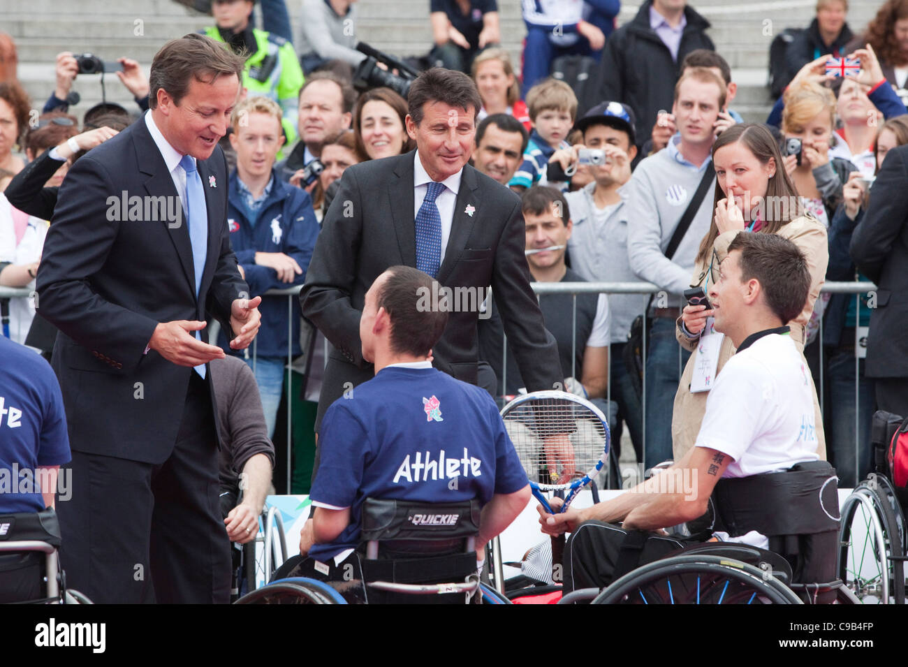David Cameron and Sebastian Coe talking to wheelchair athletes on International Paralympics Day in Trafalgar Square, - Stock Image