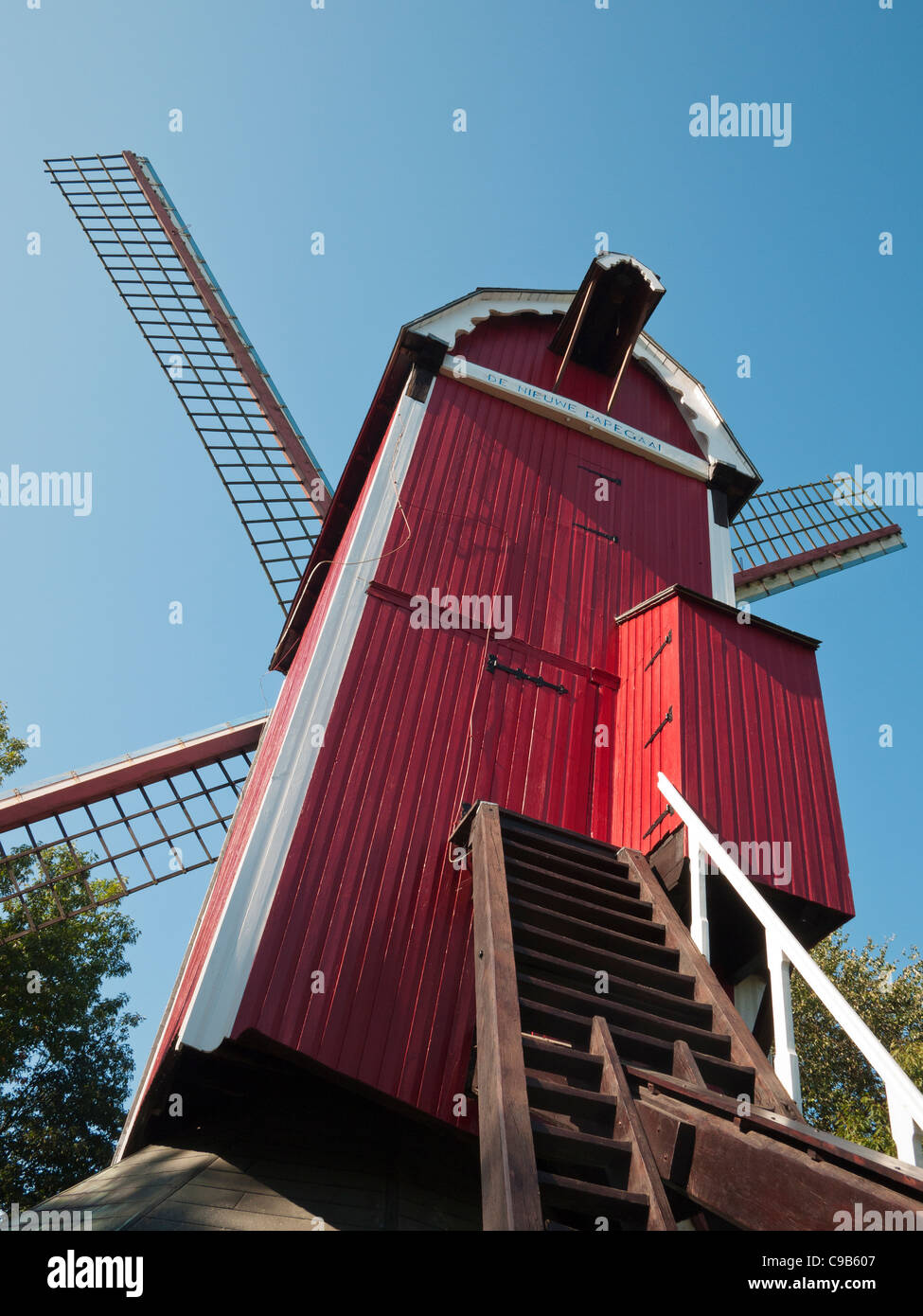 The Nieuwe Papegaai windmill, a rebuilt oil mill near the Dampoort in Bruges, Belgium - Stock Image