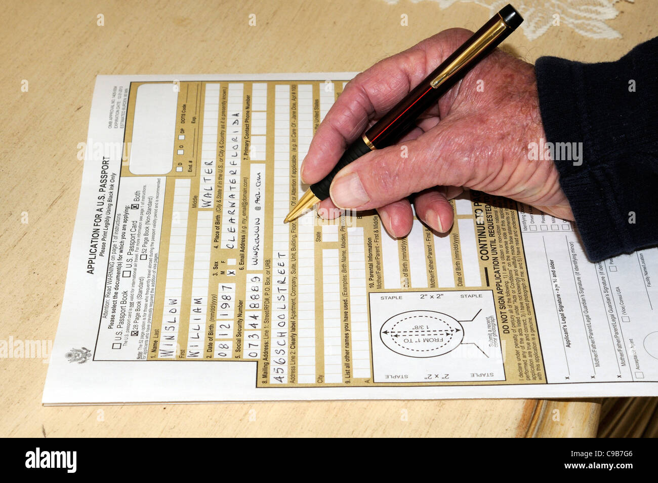 Completing An Application Form For A Us Passport Stock Photo