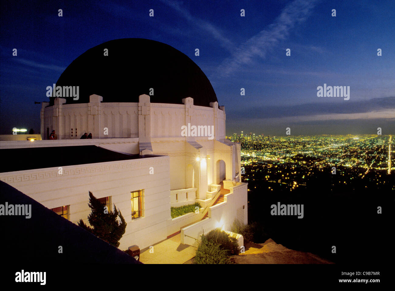 The famed 1935 Griffith Observatory attracts visitors to its art deco architecture, planetarium, and views of Los - Stock Image